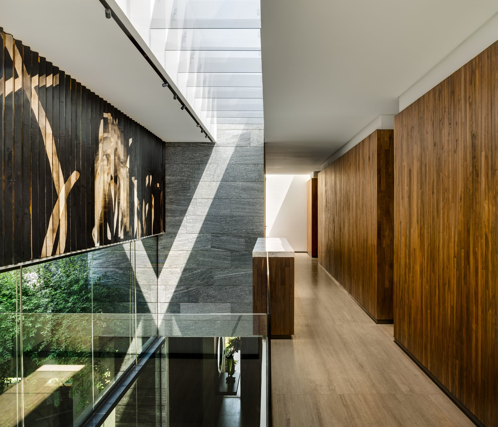 Hallway and Light Hardwood Floor  Casa O Cuatro by Migdal Arquitectos