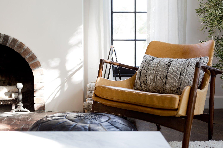 Living Room, Chair, Wood Burning Fireplace, Dark Hardwood Floor, Floor Lighting, Lamps, and Ottomans  Stearns Residence