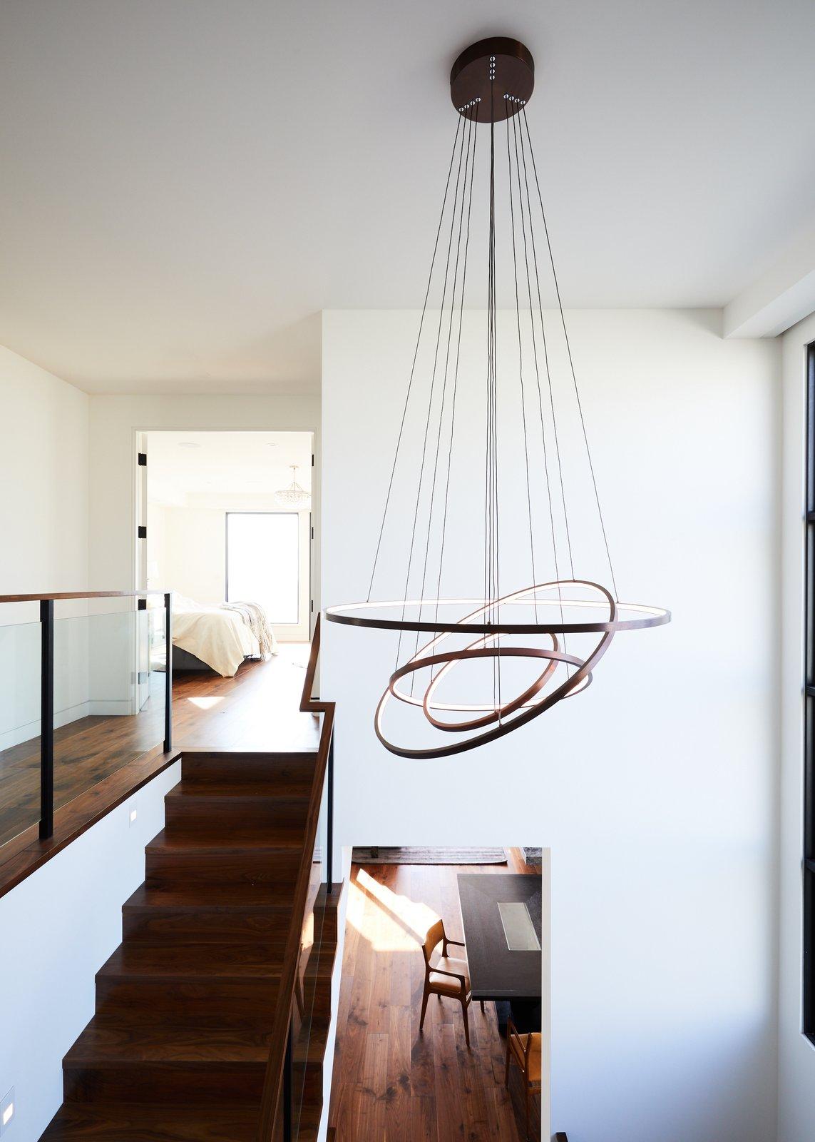 Staircase, Wood Tread, Metal Railing, Wood Railing, and Glass Railing  The Strand Residence