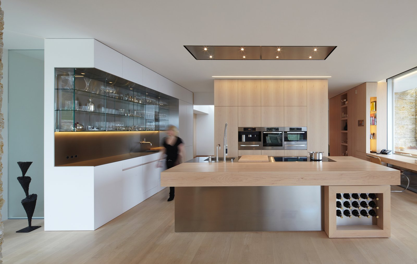 Kitchen, Metal Counter, Wood Counter, and White Cabinet  House S by Stephan Maria Lang