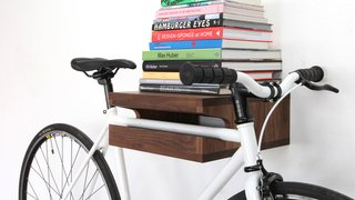 Finding a place to store larger items that are used daily is challenging. Thankfully, a beautifully crafted shelf like this from Knife and Saw elevates (both literally and figuratively) your commuter bike to the realm of sculptural art. It also provides room for your coffee table books.