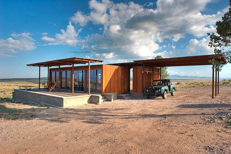 This Texas modular, dubbed the Marfa Weehouse, provides sweeping views from its sheltered deck.  Conceptualized as the first in a three dwelling compound, this home shelters a bedroom, bathroom and a covered utility shed.  Photo 10 of 10 in 5 Hot Tips to Remember When Planning Your Desert Prefab