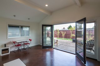 8 Modern In-Law Units - Photo 16 of 16 - In the 470-square-foot ADU, wide French doors open up to a patio and fire pit.