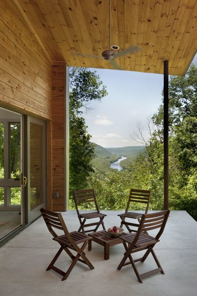 More public spaces in the house, like this open porch, were carefully sited to frame impressive views of the river and capture both sunlight and shade.