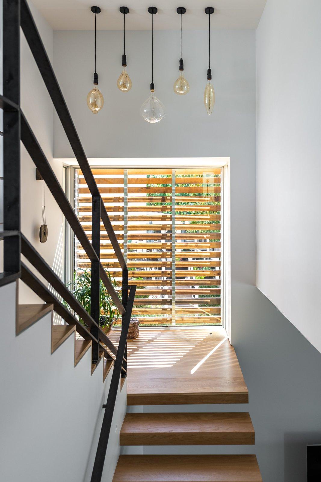 Staircase, Wood Tread, Metal Tread, and Metal Railing Stair  Spa Creek House by GriD
