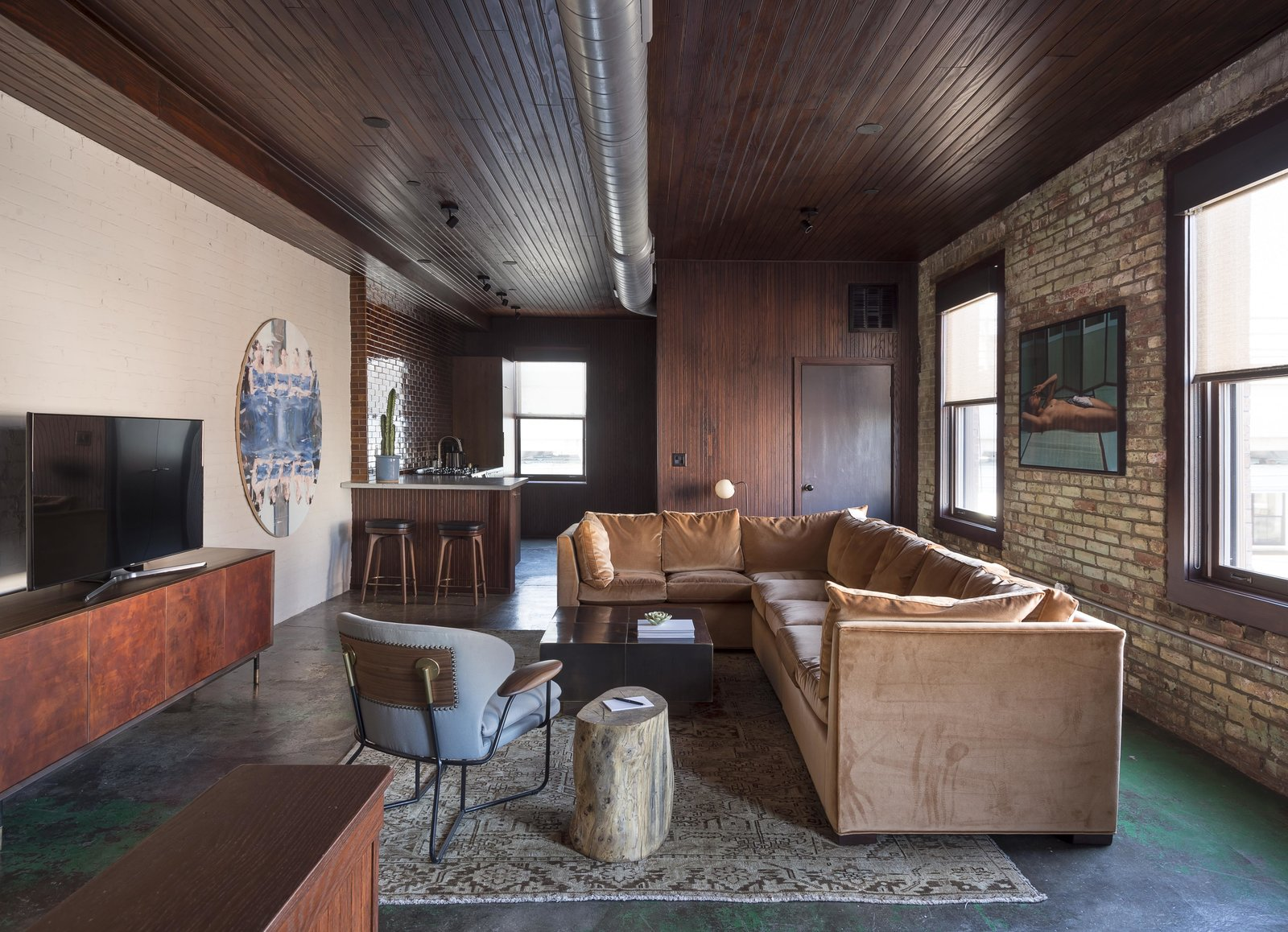 Living Room, Coffee Tables, Sectional, Chair, Ceiling Lighting, Concrete Floor, Media Cabinet, Sofa, Stools, and Storage  Mulherin's Hotel
