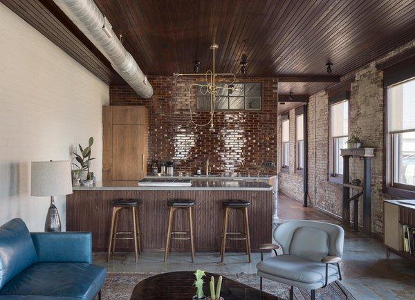 Stools, Pendant Lighting, Bar, Concrete Floor, Kitchen, Rug Floor, and Granite Counter  Mulherin's Hotel