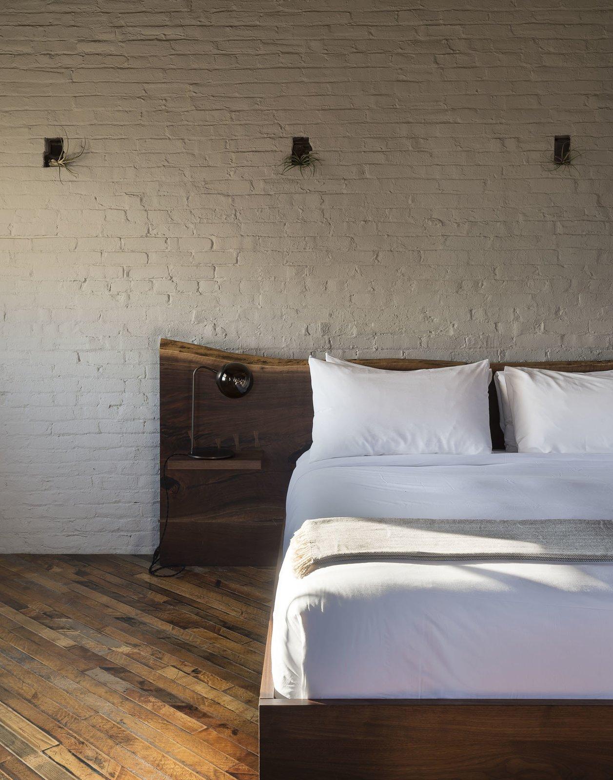 Bedroom, Bed, Lamps, and Medium Hardwood Floor  Mulherin's Hotel