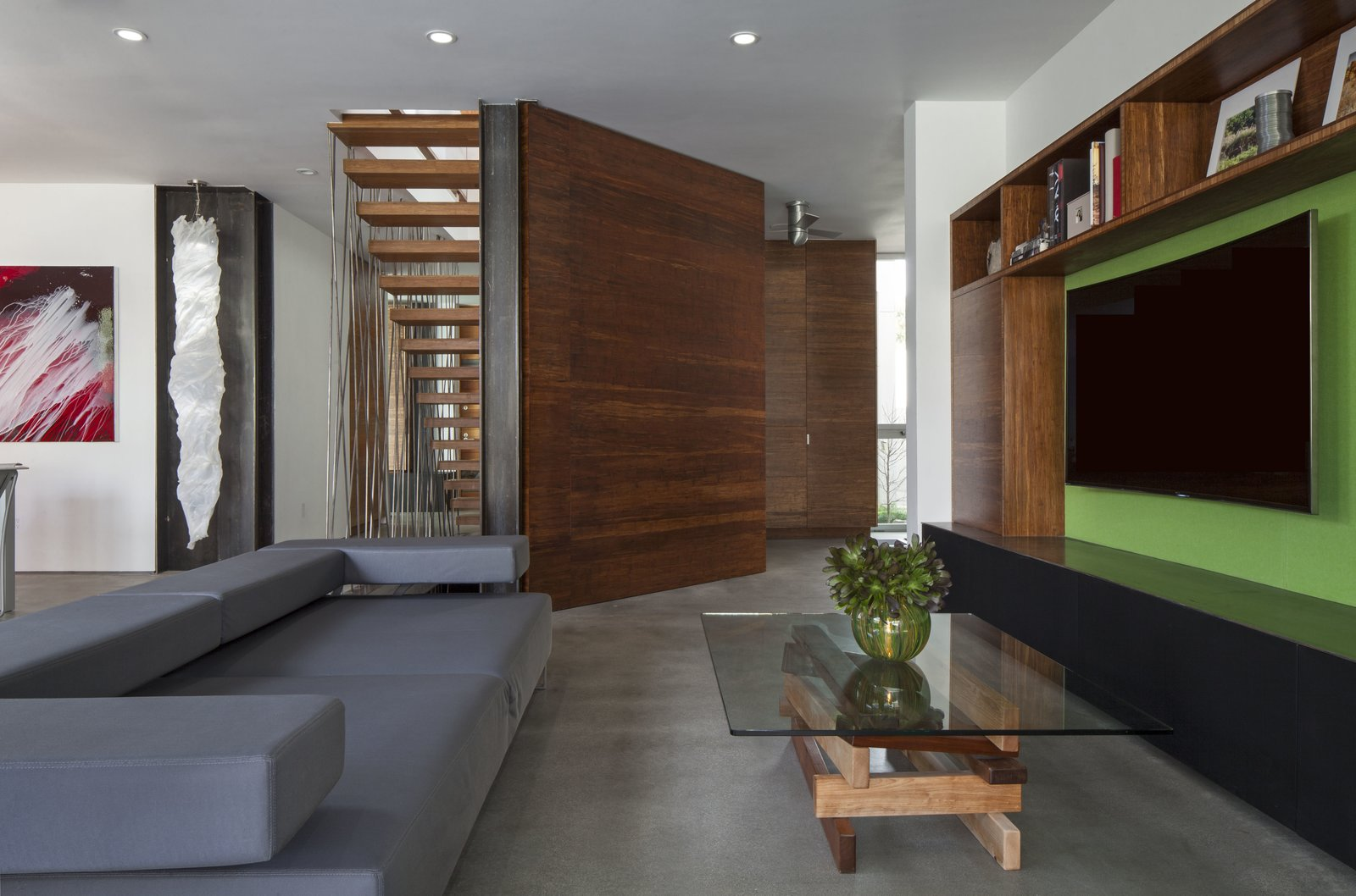 Living Room, Concrete Floor, Coffee Tables, Sofa, Recessed Lighting, Bookcase, Shelves, and Storage  Dawnsknoll by Minarc