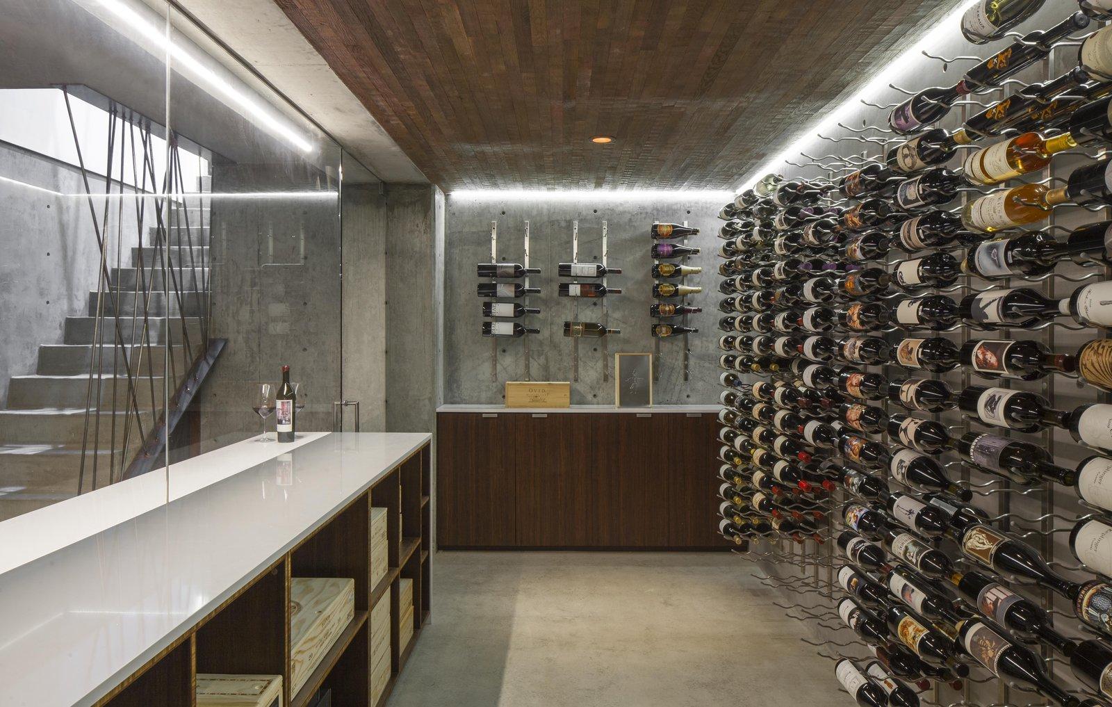 Kitchen, Accent Lighting, Quartzite Counter, Beverage Center, Wine Cooler, Concrete Backsplashe, and Concrete Floor  Dawnsknoll by Minarc