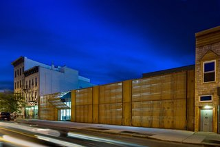 A trademark facade of laser-cut Cor-Ten steel marks The Wyckoff Exchange, a former abandoned warehouse in the Brooklyn neighborhood of Bushwick. The panels are laser cut with a dynamic gradient pattern and internally illuminated by concealed LED lighting to create a dramatic building facade.
