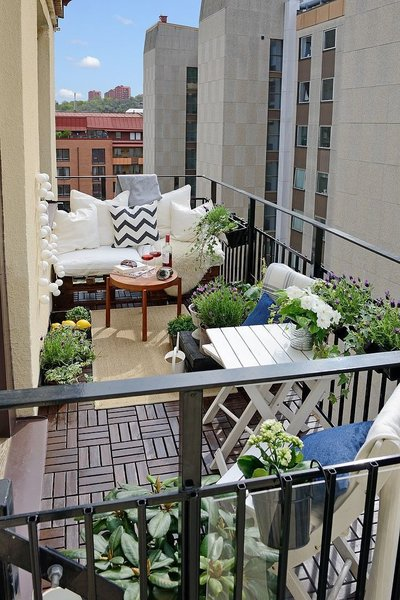 For city dwellers, a quick trip to your local Target, Home Depot (for plants!), and IKEA can yield big, modern results.  Photo 10 of 10 in 10 Ways to Use Rugs in Your Outdoor Space This Spring