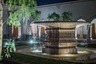 The outdoor water feature does double duty; it also serves as a water replenishment well for plants and vegetation.
