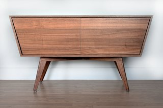 If we may boast, this takes the cake as the favorite product that we produce.<br><br>Intriguing angles, clean lines, gorgeous materials.   Designed and built in Seattle by CornerMade, this modern take on a credenza is made from 100% domestic wood with real walnut facing and solid walnut legs.