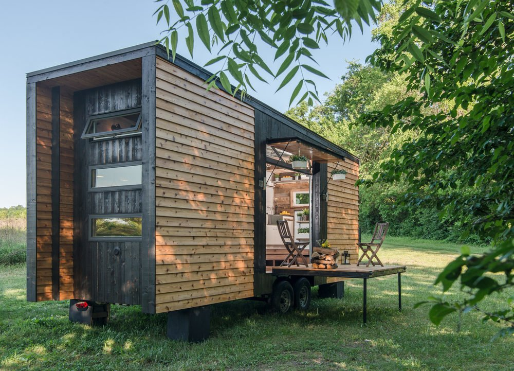Exterior, Cabin Building Type, Shed Building Type, and Wood Siding Material New Frontier Tiny Homes's Alpha Tiny Home is the company's flagship model.  Photo 4 of 10 in 10 Tiny Happy Hawaiian Huts