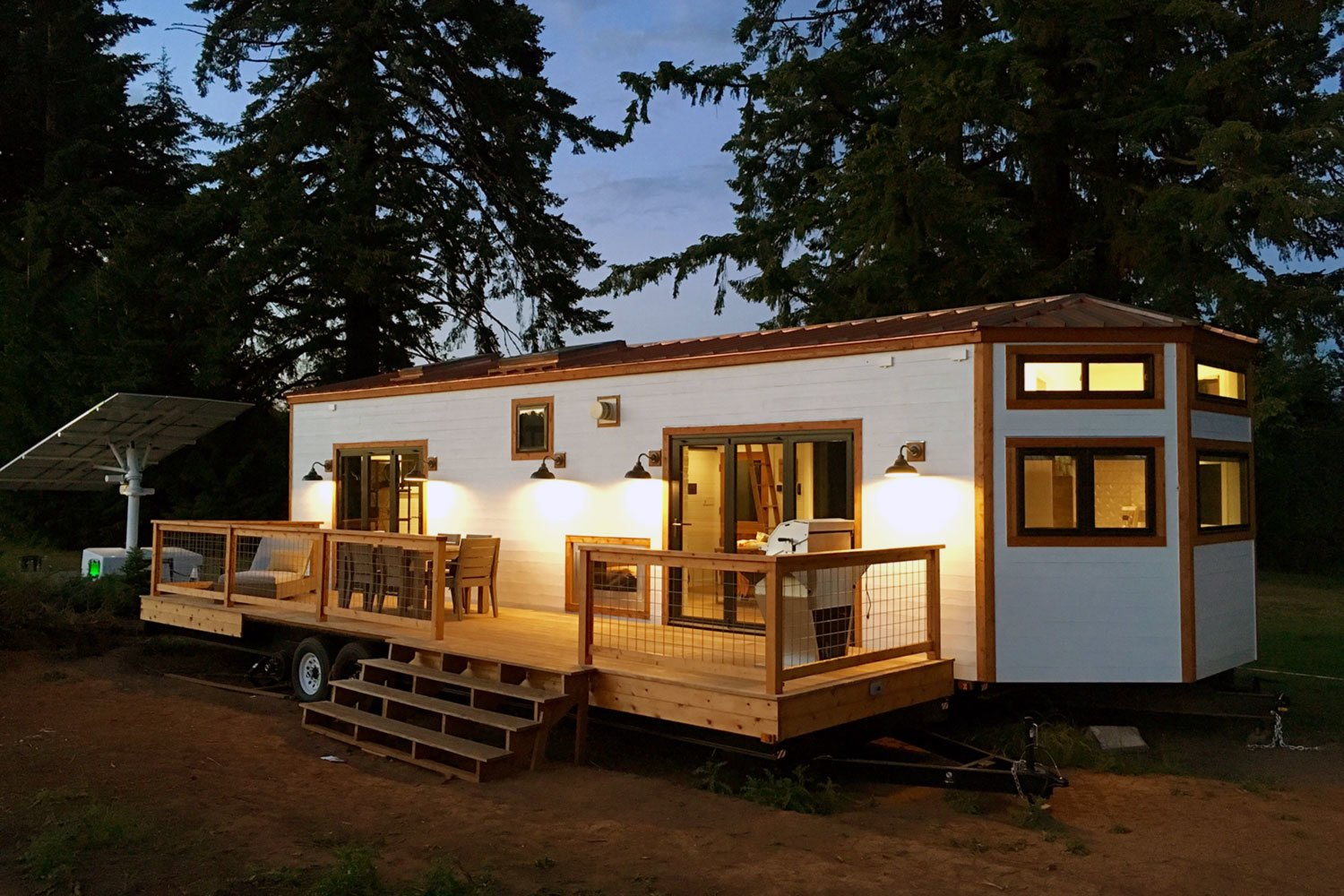This tiny house on wheels is by Tiny Heirloom. To make the home more eco-friendly, the owner installed a solar panel nearby to generate power.  Photo 10 of 10 in 10 Tiny Happy Hawaiian Huts