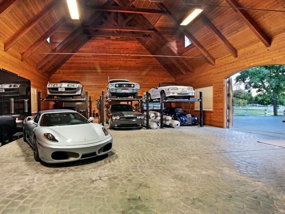 Garage How about a customized barn to house that prized classic car collection.  Barn Pros can set you up with a wide variety of packages including everything from blueprints (you could pay up to $30,000 for those alone) to lumber and hardware, ready to build—the only materials not included are nails, concrete, and the final layer of roofing.  Photo 1 of 10 in 10 Prefab Garage Solutions For Auto Enthusiasts