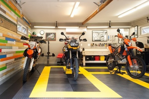 Garage and Attached Garage Room Type Add a dash of flair and color with Rubber floor coating. Some of the advantages include the low cost and resistance to mechanical and chemical damage. Rubber floors are non-slippery, resistant to extreme temperatures and are easily repaired.  Photo 6 of 10 in 10 Prefab Garage Solutions For Auto Enthusiasts