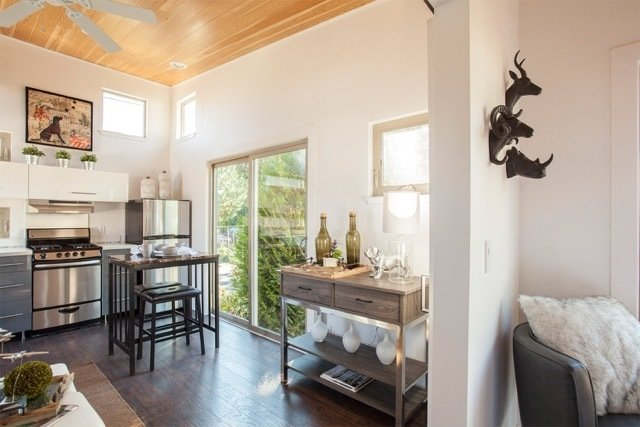 Dining Room, Recessed Lighting, Stools, Dark Hardwood Floor, and Bar The ideabox construction process goes easy on everything except quality, beauty and fun, using a highly efficient, indoor, quality-controlled construction process to build beautiful, comfortable boxes that fit your modern lifestyle.  Photo 4 of 11 in 10 Kit Home Companies to Watch