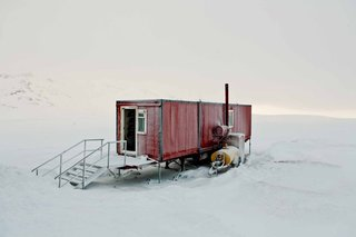 When it comes to demonstrating the hardiness of shipping containers as homes in harsh environments, it doesn't get any more incredible than this example captured by photographer Bryce Johnson in the bleak wilderness of Iceland.