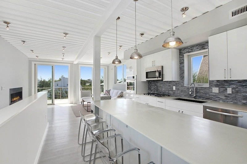This luxury modern beach home, located in the dunes in Amagansett, New York, was constructed in modular units from re-purposed steel shipping containers. Beach Box, which is located about 600 feet from the ocean, was built with EcoTop counters, tankless water heating, a 16 SEER HVAC unit, spray foam insulation, a white thermoplastic roof, Energy Star appliances, and FSC-certified cypress siding and decking and white oak floors.  Photo 10 of 12 in 10 Beautiful Island-Style Shipping Container Homes