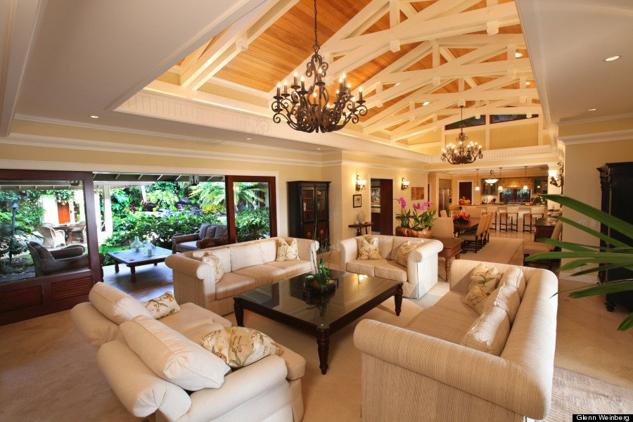 """The Obamas's first rental choice—where they stayed in 2009 and 2010—is impressive. The Plantation Estate, unofficially known as the """"Winter White House"""", opens up to a lagoon-style pool in the front courtyard with cascading waterfalls and a lavish heated spa. We imagine Barack and Michelle sipping piña coladas while Sasha and Malia splashed around in the heated pool.  Photo 2 of 10 in 10 Dream Modern Home Rentals In Hawaii"""