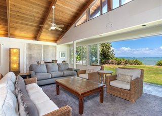 Drive down the driveway, past an enormous banyan tree, to this large home. This classic Hawaiian home, with its original lava rock wall entrance, is the main house on one of east Oahu's larger ocean front properties. It has been remodeled, while maintaining its original Hawaiian charm.