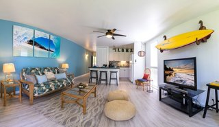 "No trip to Hawaii is complete without exploring the surfer culture and lifestyle, or even having a go yourself at this ""sport of kings"", which originated itself on the islands. If you want to stay in a place that embodies all the charm and energy of the North Shore lifestyle, this 1 bedroom 1 bath, with enclosed, spacious lanai is the perfect place to get away from it all. If you happen to like some turf with your surf, the apartment looks out to the renowned Arnold Palmer 19-hole golf course and a charming cluster of mature banyan trees."