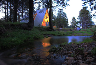 This modern A-frame is in a beautiful remote location in California's Sierra National Forest at an elevation of 7,000 feet. Siting 14 miles above Bass Lake on the Sierra Vista Scenic Byway, this property is surrounded by amazing meadows, secret swimming holes, and miles and miles of undiscovered hiking trails. It's your own private Yosemite without the crowds.
