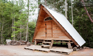 "This small, rustic, hand-built cabin deep in the Northern California woods is part of a remote, off-grid ""village"" that includes a few other cabins, goats, chickens, dogs, cats, permaculture gardens, and all kinds of cool, sustainable, DIY infrastructure."