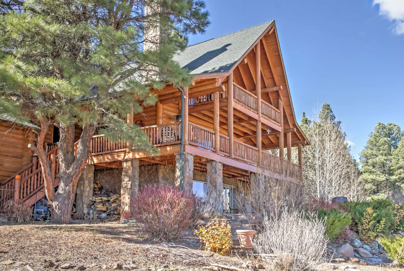 Grant yourself the ultimate escape to the Grand Canyon State with this stunning 3-bedroom, 3.5-bathroom Flagstaff vacation rental cabin, which sleeps 10 guests comfortably. Chock-full of amenities and situated in a private scenic landscape. Tagged: Exterior, Cabin Building Type, A-Frame RoofLine, Shingles Roof Material, and Wood Siding Material.  Photo 12 of 12 in Alfie the A-Frame and 10 Other A-Grade Accommodations