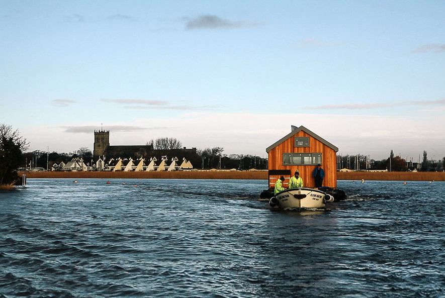 Upon delivery, Big Red was too big to fit through the narrow woodland track that provides access to Mudeford Spit, forcing Ecologic Developments to secure two ex-military pontoons that they use to float Big Red in down the river, bypassing the tight woodland.  Photo 9 of 15 in 14 Really Romantic Island Resort Retreats