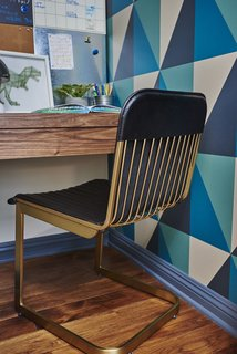 Geometric wallpaper in navy, teal and oatmeal creates graphic appeal in the boys' bedroom.