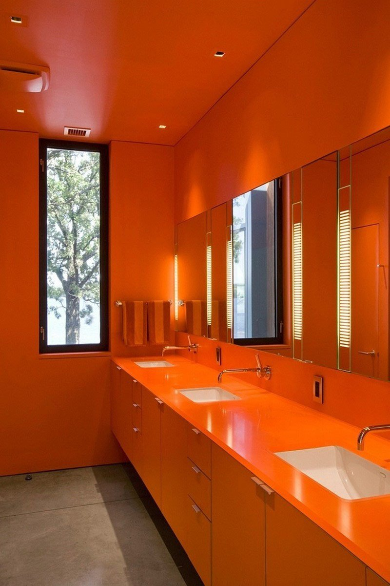 Orange livens this bathroom to the highest degree. Min Day has garnered numerous awards including the 2007 AIA California Emerging Talent award, New Practices San Francisco 2009, California Home & Design's 2009 Ten to Watch, Residential Architect's 2010 Rising Star, Architectural Record Magazine's 2009 Design Vanguard, and the Architectural League of New York's 2016 Emerging Voices.  Photo 3 of 11 in These 10 Designers Are Experts at Creating Colorful Bathrooms That Pop