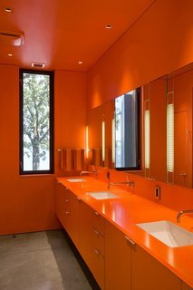 Orange enlivens this bathroom to the highest degree. Min Day has garnered numerous awards including the 2007 AIA California Emerging Talent award, New Practices San Francisco 2009, California Home & Design's 2009 Ten to Watch, Residential Architect's 2010 Rising Star, Architectural Record Magazine's 2009 Design Vanguard, and the Architectural League of New York's 2016 Emerging Voices.