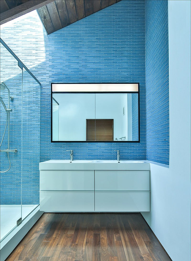 MFA, an architecture firm based in Los Angeles, is committed to seeking a sustainable architecture of innovative space; a space that is shaped by the specific needs of the client,  the unique qualities of the site and region, and the logic and efficiency of construction.  Photo 5 of 11 in These 10 Designers Are Experts at Creating Colorful Bathrooms That Pop