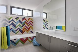 No need to stick to a single color; a bold, multi-hued mosaic effect here, combined with the primary colored towels makes the difference. Exactus was established by Ralph Brewer, a builder with over 25 years experience in the industry.