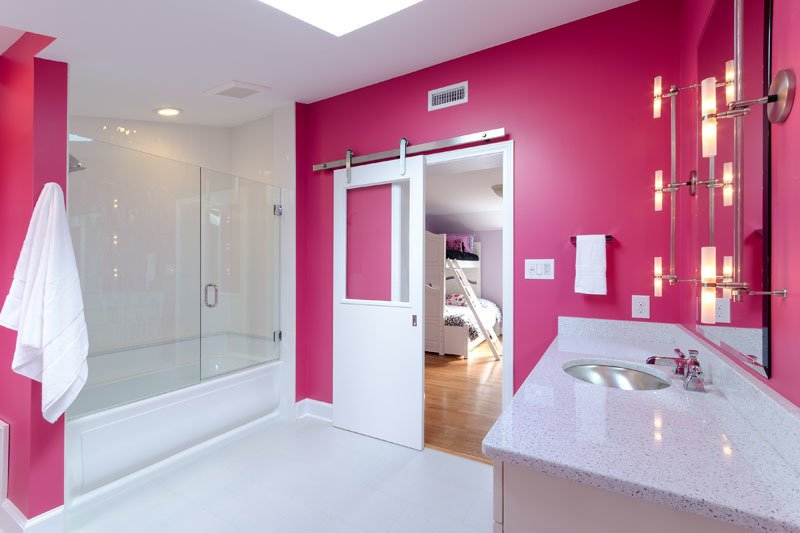 Pink heats up this renovation by Virginia-based Design Line.  Photo 7 of 11 in These 10 Designers Are Experts at Creating Colorful Bathrooms That Pop