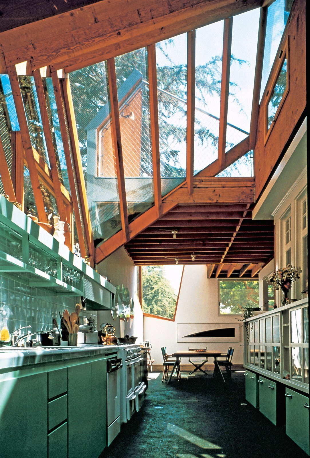 Originally built in 1920 and purchased by Gehry in 1977, the Gehry House features a metallic exterior wrapped around the original building that leaves many of the original details visible. Tagged: Kitchen and Subway Tile Backsplashe.  Photo 1 of 14 in 13 Iconic Buildings Designed by Frank Gehry