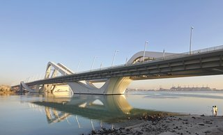 "Conceived in an open setting, the Sheikh Zayed Bridge has the prospect of becoming a destination in itself and a potential catalyst in the future urban growth of Abu Dhabi. A collection—or strands of structures—gathered on one shore, are lifted and ""propelled"" over the length of the channel. A sinusoidal wave form provides the structural shape across the channel."