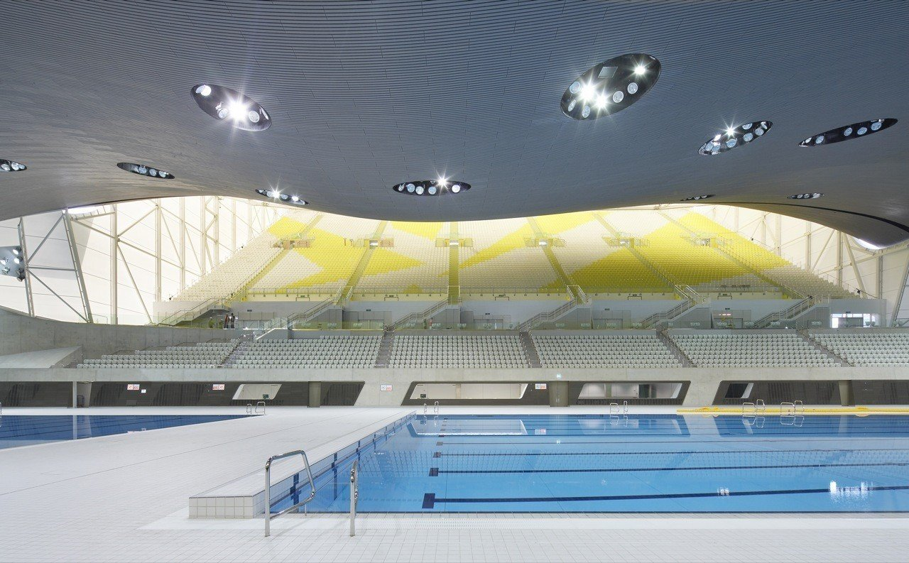 """One of the main venues of the 2012 Summer Olympics and the 2012 Summer Paralympics, the centre was used for the swimming, diving and synchronized swimming events. After significant modification, the centre opened to the public in March 2014.  Photo 9 of 18 in """"Queen of the Curve"""": 18 Influential Works by Zaha Hadid"""
