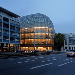As a landmark in the city of Cologne, the curved front facade of this distinctive department store cantilevers subtly out into the area's pedestrian zone, strengthening the presence of the store along a major pedestrian and shopping axis.