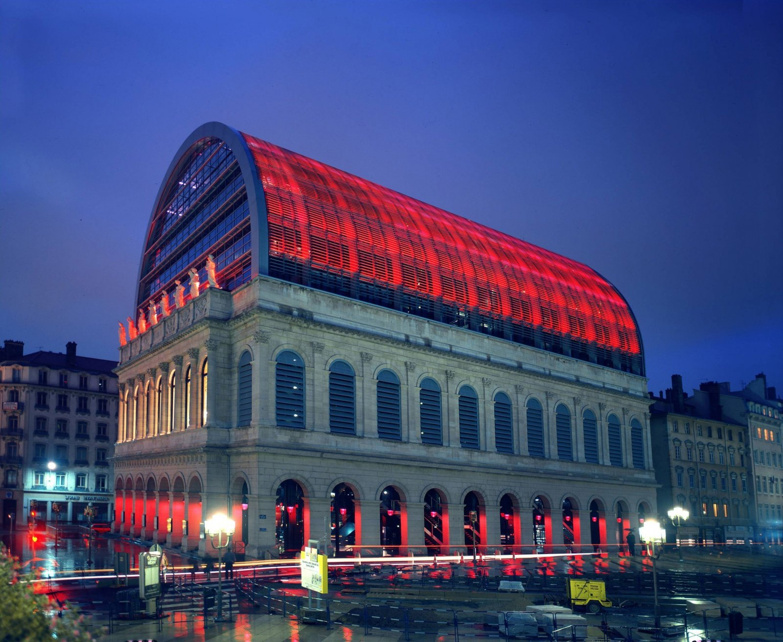 Jean Nouvel won a competition to  renovate the original opera house. Melding past and present, the project increased interior space, added an underground practice hall and doubled the buikding's height with a steel and glass vault.  Photo 5 of 11 in 10 Jean Nouvel Buildings We Love