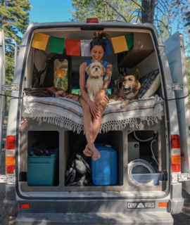 """9 Adventure Seekers Who Celebrate Small Space Living Through the Van Life - Photo 8 of 10 - """"Adventure culture isn't about privilege,"""" says Noël Russell. She continues, """"It isn't about vacation with pay, or sponsored trips to the tropics, or alpine ascents (though, for some, it is). Adventure culture is a spirit of curiosity and awe. It's approaching the everyday—and the fantastic—with boldness and grit. I work at a homeless shelter, and every day is an adventure. My daily view doesn't fit the aesthetic of outdoor magazine ads or travelogues, but every day I get to explore new corners of people's hearts."""""""