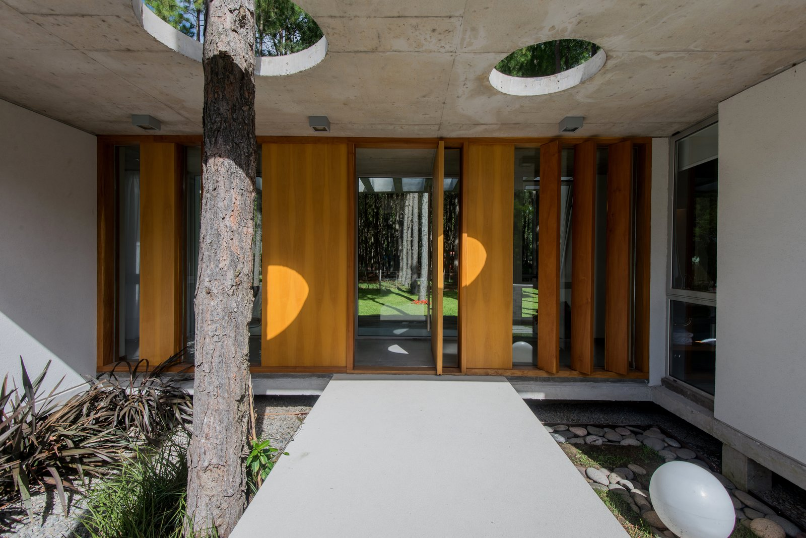Outdoor, Front Yard, Trees, Wood Patio, Porch, Deck, Concrete Patio, Porch, Deck, and Stone Patio, Porch, Deck  Best Photos from Casa Batin