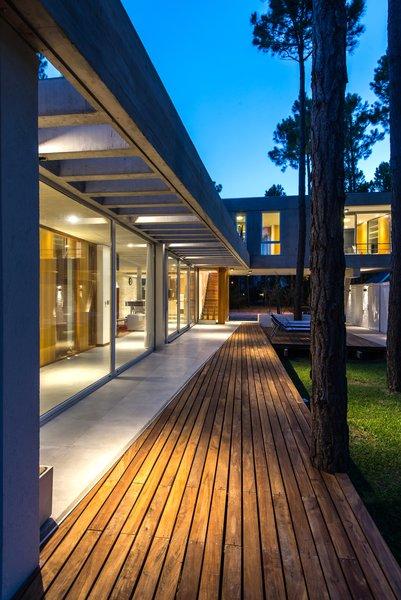 Outdoor, Back Yard, Trees, Tile Patio, Porch, Deck, Decking Patio, Porch, Deck, and Wood Patio, Porch, Deck  Casa Batin by Estudio Galera