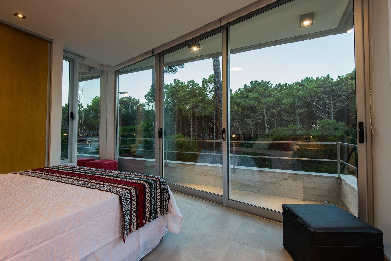 Tagged: Bedroom, Bed, Storage, Ceiling Lighting, and Porcelain Tile Floor.  Casa Batin by Estudio Galera