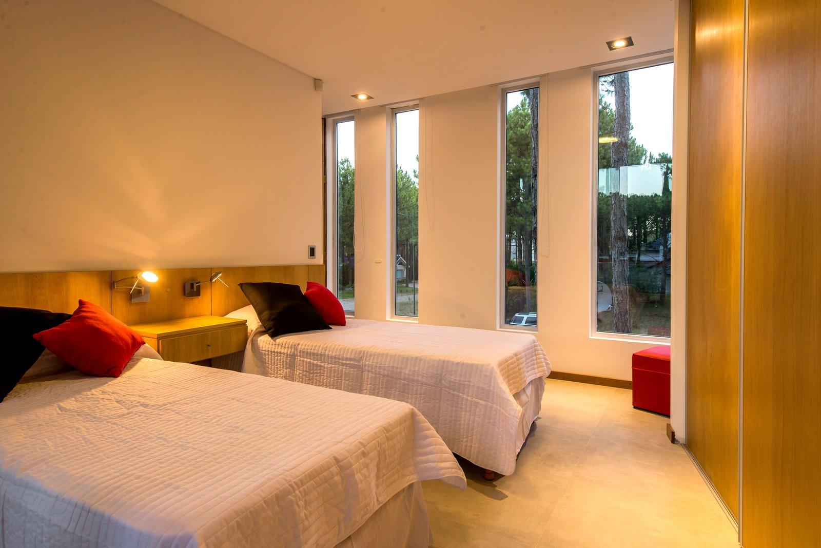 Bedroom, Night Stands, Porcelain Tile Floor, Ceiling Lighting, Wall Lighting, Bed, and Storage  Casa Batin by Estudio Galera