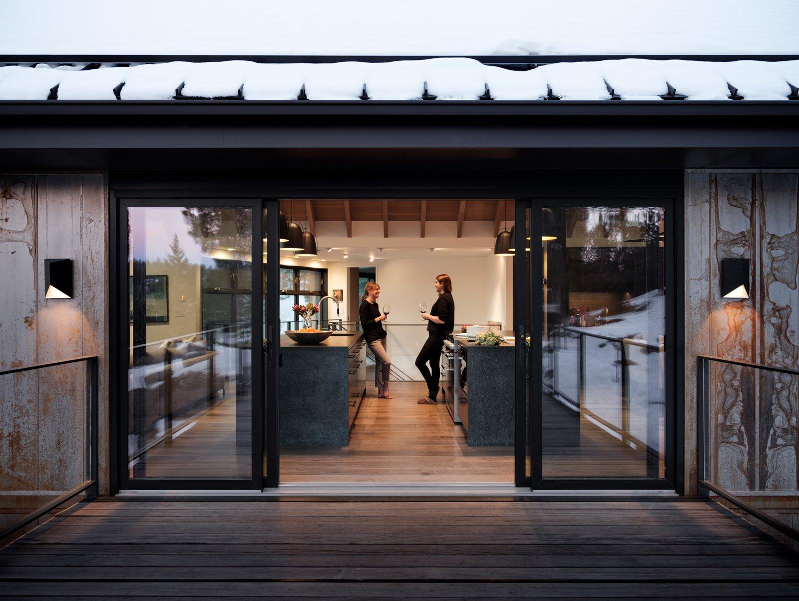 Kitchen, Dishwasher, Dark Hardwood Floor, Cooktops, Wood Cabinet, Undermount Sink, and Pendant Lighting  Modern Cabin by HMHAI