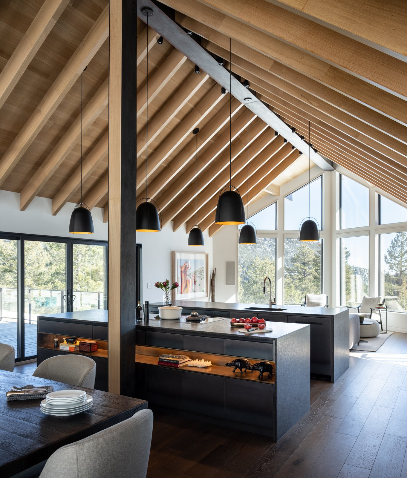 Kitchen, Undermount Sink, Dark Hardwood Floor, Wood Cabinet, Range, and Pendant Lighting  Modern Cabin by HMHAI
